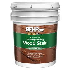 5 Expert Tips For Staining A Deck Consumer Reports by Behr Deckplus 1 Gal Deep Base Solid Color Waterproofing Wood