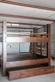 custom full xl loft bed over queen platform bed features paneled