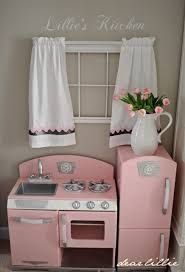 play kitchen ideas curtains and flowers added to a wooden play kitchen such a