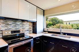 Black And White Contemporary Kitchen - black and white modern kitchen room with multi color backsplash