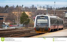 modern passenger train stands on small station stock image image