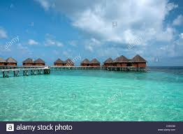 overwater bungalows in beautiful blue lagoon maldives stock photo