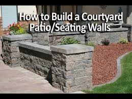 How To Build A Stone Patio by How To Build A Patio Enclosure With Seating Walls Youtube