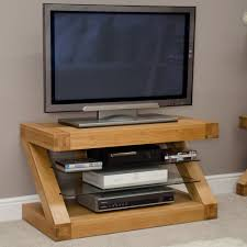 Tv Table Design Wood Well Turned Led Tv Above Dvd Player And Books On Glass Layer Fit
