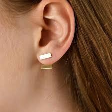 two earrings two way golden bar stud earrings by gaamaa notonthehighstreet