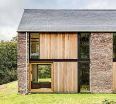 Frame House Steel Frame House Clad In Stone And Timber Pinteres