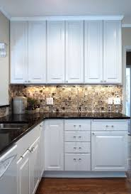 white kitchen with backsplash white kitchen with glass mosaic backsplash traditional kitchen