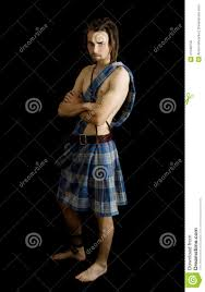 young man dressed in a scottish kilt royalty free stock photos