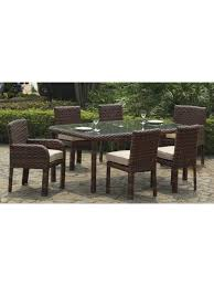 modern rectangle clear glass top dining table and wicker chairs