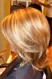partial red highlights on dark brown hair photos of real hair behind my chair with a brief description of my