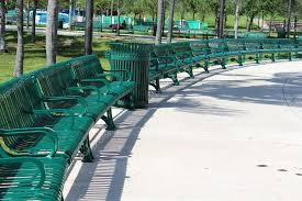 neat and orderly semi circle arrangement of green metal benches in