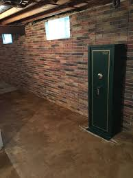 this basement wall is a poured concrete with a brick texture i