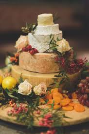 best 25 wedding cake display ideas on pinterest nature wedding love a good cheese wheel cake cheese table eggs