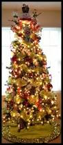 mesh ribbon and ornament decorated christmas tree holidays