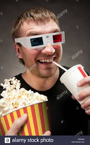 Meme Eating Popcorn - funny man watching 3d movie drinking soda and eating popcorn