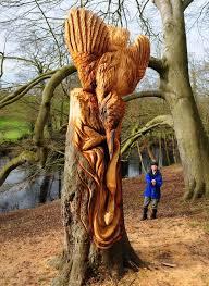 banksy like artist leaves intricate carvings in market town s