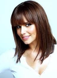 medium hairstyles for hispanic women beautiful hispanic woman with long wind blown hair photo by justin