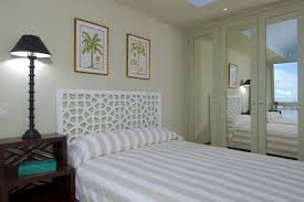 headboard with built in bedside tables beautiful tropical bedroom closet doors decoratively mirrored doors