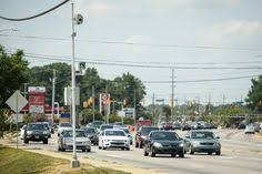 illinois red light camera rules a sign warns motorists of the presence of a red light camera in