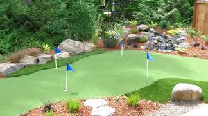 putting green with water fall and pavers youtube