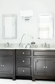 best 25 dark wood bathroom ideas on pinterest dark cabinets a dark wood vanity creates contrast against bright white walls in this transitional bathroom the
