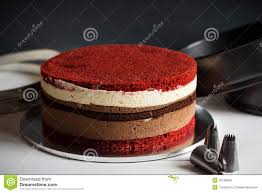 layer cake with red velvet and chocolate biscuit and cream