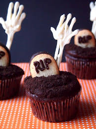 the tiny funnel skeleton hand graveyard cupcakes