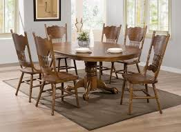 Country Dining Room Sets by Oak Finish Round Oval Dining Table With Single Pedestal