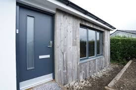 rationel modern entrance door with matching grey colour to windows