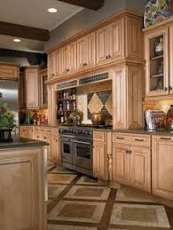 wellborn forest cabinets reviews open floor plan kitchen maple cabinets with black crown moulding