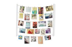amazon com umbra hangit photo display diy picture frames amazon com umbra hangit photo display diy picture frames collage set includes picture hanging wire twine cords natural wood wall mounts and clothespin