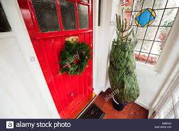 christmas tree delivery christmas wreath on a door and christmas tree delivery stock