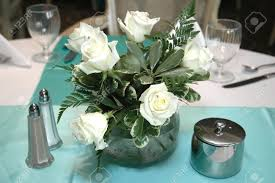 Formal Dining Table by White Roses Centerpiece On Formal Dining Table Stock Photo