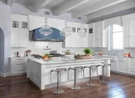 white kitchen with silver iridescent glass backsplash tiles