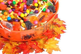bowl of halloween candy on straw stock photo picture and royalty