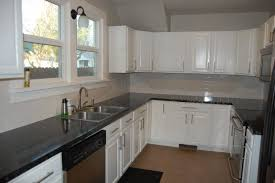 Neutral Colors For Kitchen - kitchen style farmhouse classic white kitchen cabinets with black