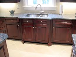 rosewood kitchen cabinets angled fluted columns bump out the sink area in this rosewood cherry