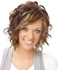 medium wavy formal hairstyle with side swept bangs medium
