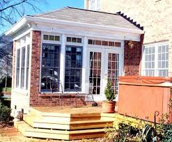 House With Sunroom Sunroom Done In Brick W Hip Roof Sunrooms Photo Gallery