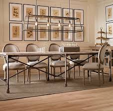 restoration hardware flatiron table louis xvi chairs paired with an industrial vibe table from
