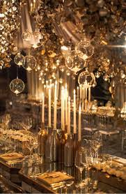 Gold Christmas Centerpieces - metallic gold bottles as candle holders are great holiday