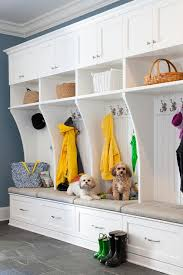 white and blue mudroom features white mudroom lockers accented