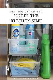 Under Kitchen Sink Storage by How To Organize The Cabinet Under Your Kitchen Sink