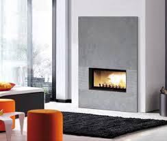 cheminée aéro en céramique coloris béton et foyer atra 16 9 800