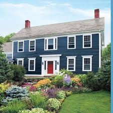 grey exterior paint white trim dark navy shutters and a