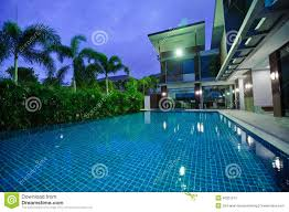modern house with swimming pool at night stock photo image 40351241