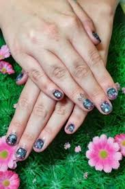 pastel pink and green rock band musical instrument nail art on