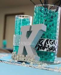 sweet 16 table centerpieces black turquoise sweet sixteen centerpiece with water