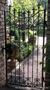 lonestar custom fabricates wrought iron entrance gates in dallas
