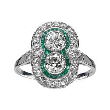 platinum art deco diamond ring with calibrated emeralds